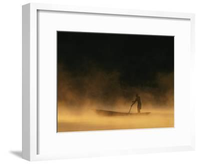 Night Fisherman in a Dugout Canoe on the Zambezi River-Chris Johns-Framed Photographic Print