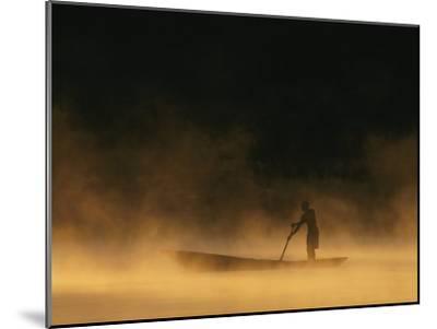 Night Fisherman in a Dugout Canoe on the Zambezi River-Chris Johns-Mounted Photographic Print