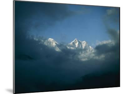 Mount Everest (Left) and Mount Lhotse (Right) Almost Obscured by Clouds-Michael Klesius-Mounted Photographic Print