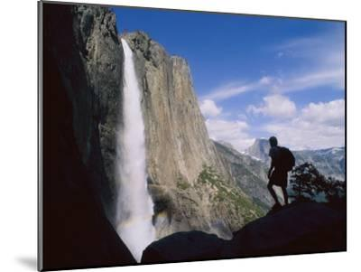 Hiker Viewing Yosemite Falls-Bill Hatcher-Mounted Photographic Print