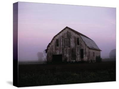 Pink Dawn Mist Around a Weather-Beaten Barn-Stephen St^ John-Stretched Canvas Print