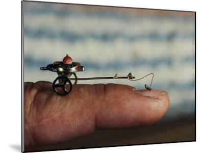 A Flea Pulls a Small Cart Along an Outstretched Finger-Nicole Duplaix-Mounted Photographic Print