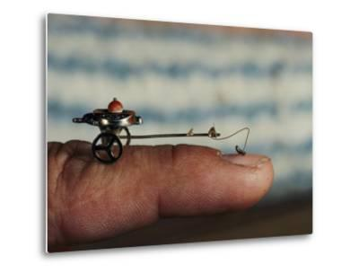 A Flea Pulls a Small Cart Along an Outstretched Finger-Nicole Duplaix-Metal Print