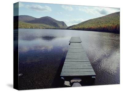A Scenic View of a Dock on a Lake-Bill Curtsinger-Stretched Canvas Print