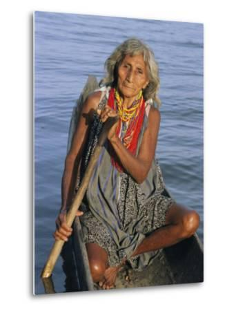 A Warao Indian in a Canoe-Ed George-Metal Print