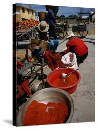 Women from Small Patou Island Grind Chilies to Powder, Dali, Yunnan, China-Diana Mayfield-Stretched Canvas Print