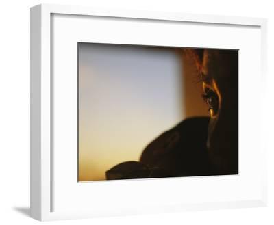 Close View of a Womans Profile Shadowed in the Late Afternoon Light-Raul Touzon-Framed Photographic Print