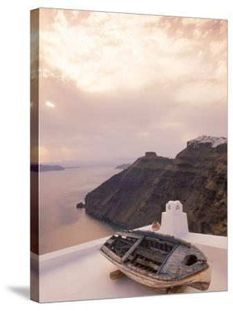 Boat at Sunset, Santorini, Greece-Walter Bibikow-Stretched Canvas Print