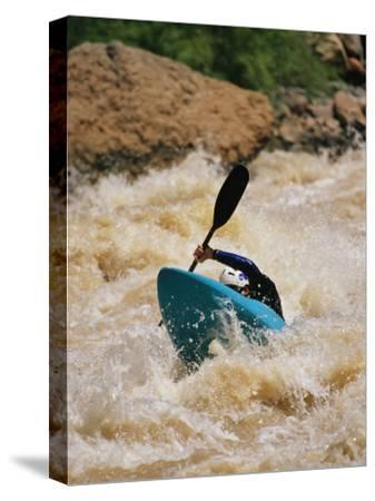 Kayaker Paddles Through Colorado River Rapids-Mark Cosslett-Stretched Canvas Print