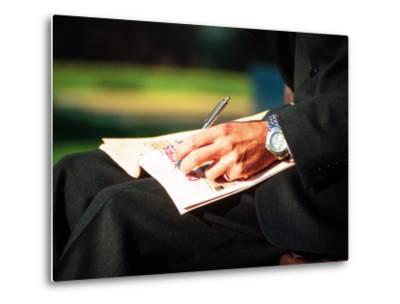 Businessman Writing on Newspaper-Stephen Umahtete-Metal Print