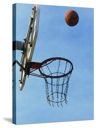 Low Angle View of a Basketball Bouncing Off The Hoop--Stretched Canvas Print
