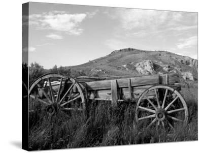 Old Wood Wagon near Mining Ghost Town at Bannack State Park, Montana, USA-John & Lisa Merrill-Stretched Canvas Print