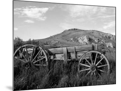Old Wood Wagon near Mining Ghost Town at Bannack State Park, Montana, USA-John & Lisa Merrill-Mounted Photographic Print