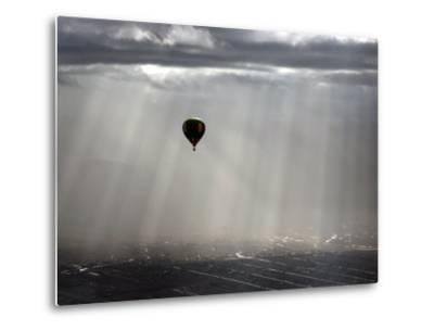 A Lone Balloon Drifts Near the Foothills of Albuquerque, N.M.--Metal Print