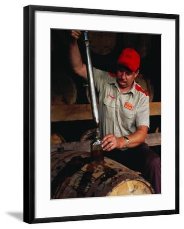 Taking Sample from Whisky Barrel at Makers Mark Distillery, Bardstown, United States of America-Richard I'Anson-Framed Photographic Print