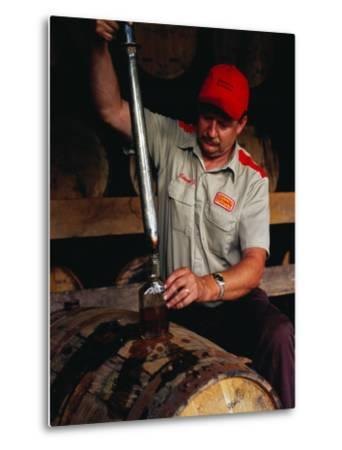 Taking Sample from Whisky Barrel at Makers Mark Distillery, Bardstown, United States of America-Richard I'Anson-Metal Print