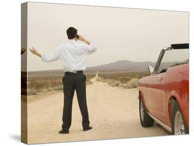 Male Young Adult on Cell Phone with Broken Down Car--Stretched Canvas Print
