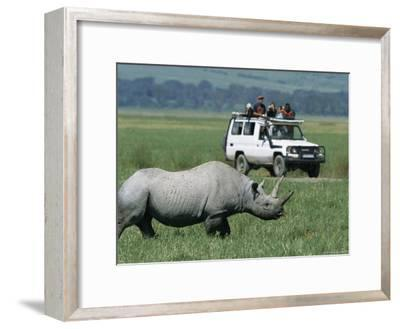 Tourists View a Rhinoceros from a Safari Jeep-Richard Nowitz-Framed Photographic Print
