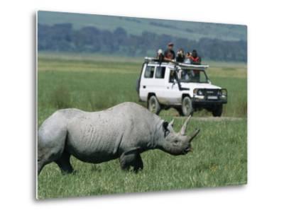 Tourists View a Rhinoceros from a Safari Jeep-Richard Nowitz-Metal Print