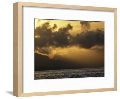 Twilight View of Backlit Clouds over Silhouetted Hills and Calm Water-Tim Laman-Framed Photographic Print
