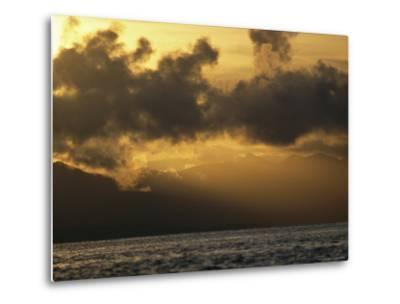 Twilight View of Backlit Clouds over Silhouetted Hills and Calm Water-Tim Laman-Metal Print