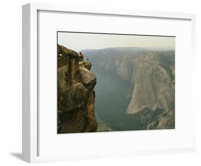 Two Climbers Take in the View of Yosemite Valley from Taft Point-Bill Hatcher-Framed Photographic Print