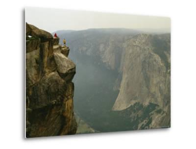 Two Climbers Take in the View of Yosemite Valley from Taft Point-Bill Hatcher-Metal Print