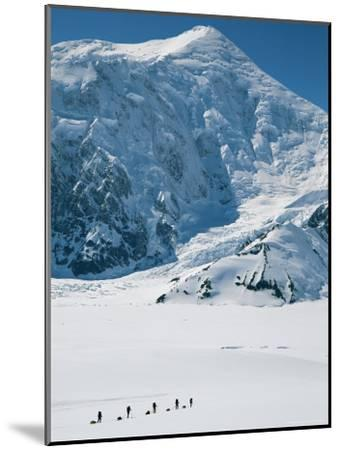 Climbers Hike Through a Snowy Landscape on Their Way to Denali-Bill Hatcher-Mounted Photographic Print