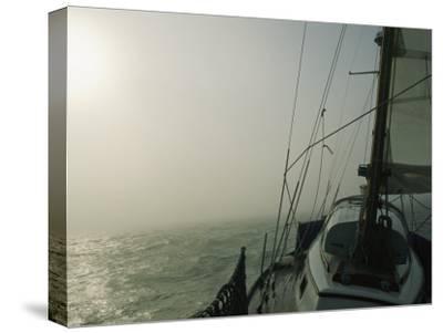 Fog Blankets a Sailboat in San Francisco Bay-Rich Reid-Stretched Canvas Print