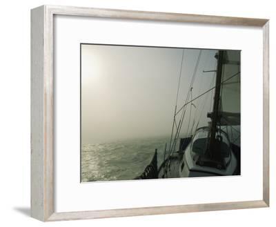 Fog Blankets a Sailboat in San Francisco Bay-Rich Reid-Framed Photographic Print