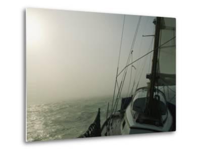 Fog Blankets a Sailboat in San Francisco Bay-Rich Reid-Metal Print