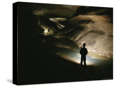 Cavers Stand in the New Discover Section of Meringo Cave-Stephen Alvarez-Stretched Canvas Print