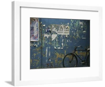 A Bicycle is Parked against a Blue Wall-Todd Gipstein-Framed Photographic Print