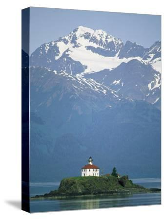 The Chilkat Range Looms Above the Eldred Rock Lighthouse--Stretched Canvas Print