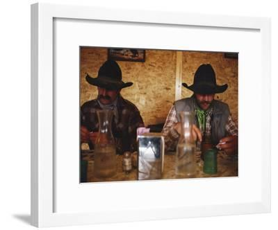 A Pair of Cowboys Enjoy a Cup of Coffee at a Local Restaurant--Framed Photographic Print