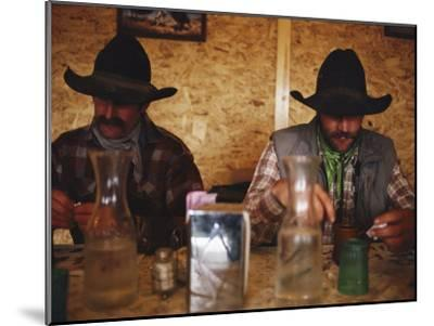 A Pair of Cowboys Enjoy a Cup of Coffee at a Local Restaurant--Mounted Photographic Print