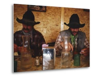 A Pair of Cowboys Enjoy a Cup of Coffee at a Local Restaurant--Metal Print