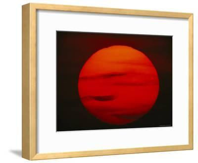 The Sun, Glowing Red as It Sets--Framed Photographic Print