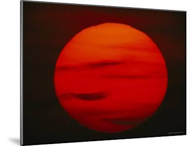 The Sun, Glowing Red as It Sets--Mounted Photographic Print
