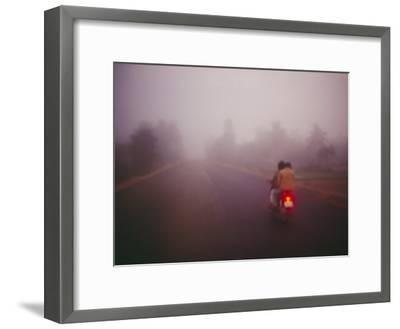 A Couple on a Motorcycle Head into Town Early in the Morning--Framed Photographic Print