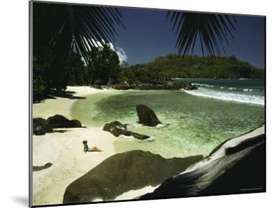 A Woman Sitting on an Idyllic Tropical Beach-Bill Curtsinger-Mounted Photographic Print