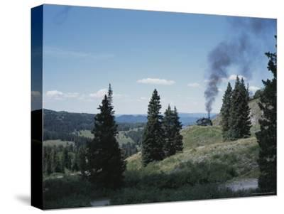 A Steam Engine Chugs into La Manga Pass in Colorado-Taylor S^ Kennedy-Stretched Canvas Print