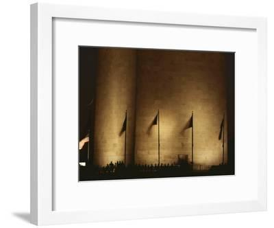 A Twilight View of American Flags Flying at the Washington Monument-Karen Kasmauski-Framed Photographic Print