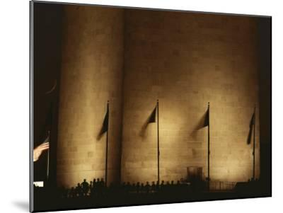 A Twilight View of American Flags Flying at the Washington Monument-Karen Kasmauski-Mounted Photographic Print