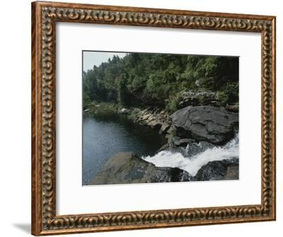 Water Flows Swiftly Through a Rocky Gorge into a Calm Pool-Medford Taylor-Framed Photographic Print
