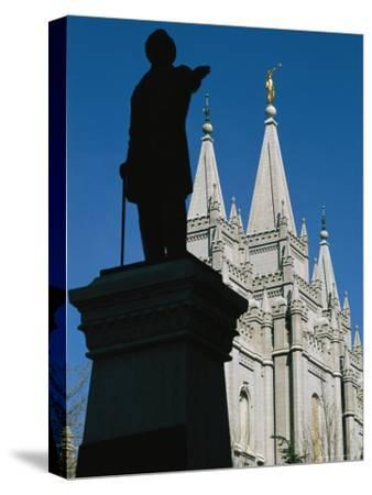 Brigham Young Statue Frames the Jesus Christ Latter Day Saints Church-Stephen St^ John-Stretched Canvas Print