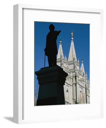 Brigham Young Statue Frames the Jesus Christ Latter Day Saints Church-Stephen St^ John-Framed Photographic Print