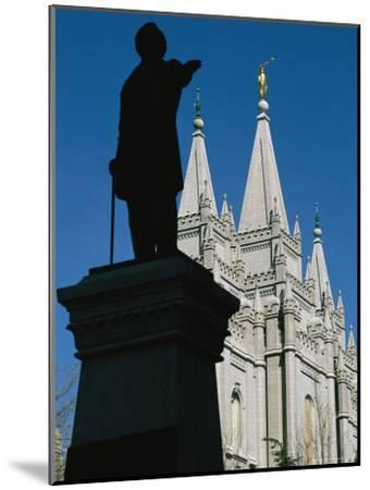 Brigham Young Statue Frames the Jesus Christ Latter Day Saints Church-Stephen St^ John-Mounted Photographic Print