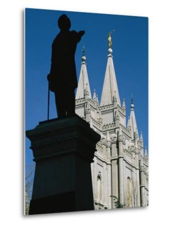 Brigham Young Statue Frames the Jesus Christ Latter Day Saints Church-Stephen St^ John-Metal Print