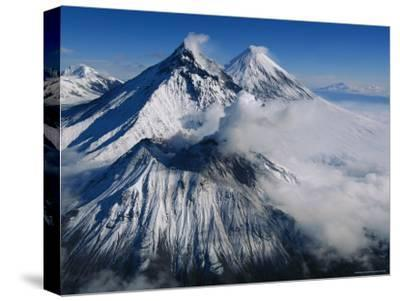 View of Kamen, Bezymianny, and Klyuchevskoy, Asias Tallest Volcano-Peter Carsten-Stretched Canvas Print